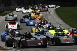 Attached image: The Spec Racer Ford field heads into Turn Five at Road America. Credit: Mark Weber